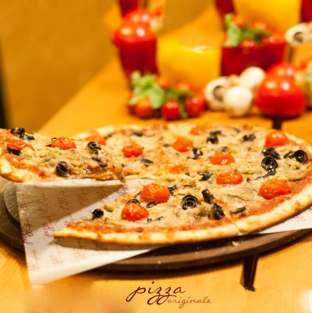 Our Artichoke and Tomato Pizza is gurantee love at first slice.